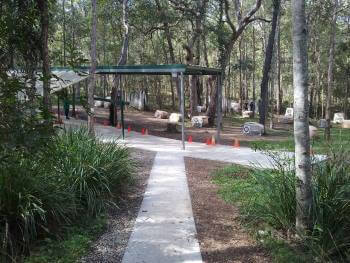 A photo of the concrete path to the practice range