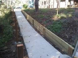A photo of the Retaining wall beside path that leads to the practice range